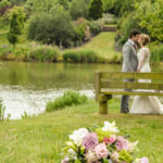 Wedding couple by ponds and arboretum